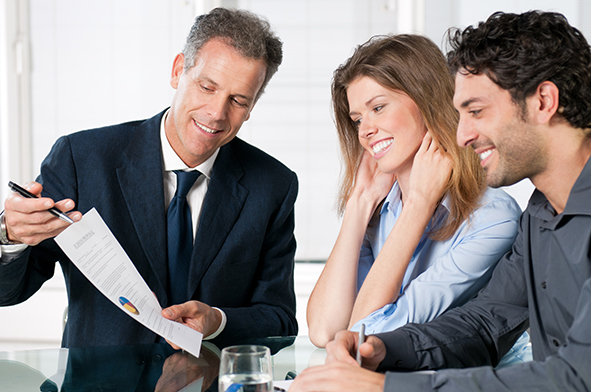stock-photo-happy-young-couple-discussing-with-a-financial-agent-their-new-investment-105216713
