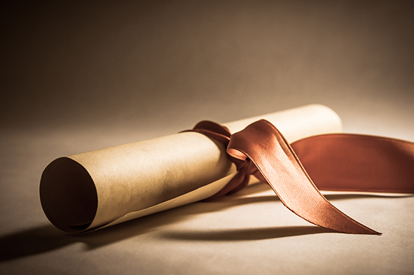 stock-photo-a-parchment-diploma-scroll-rolled-up-with-red-ribbon-laid-at-an-oblique-angle-processed-to-give-155241647