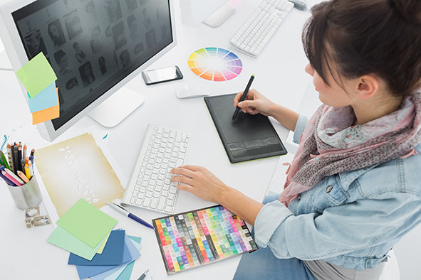 stock-photo-high-angle-view-of-an-artist-drawing-something-on-graphic-tablet-at-the-office-168161747